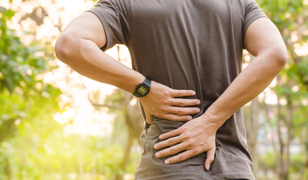 Man with lower back pain needs chiropractic care.