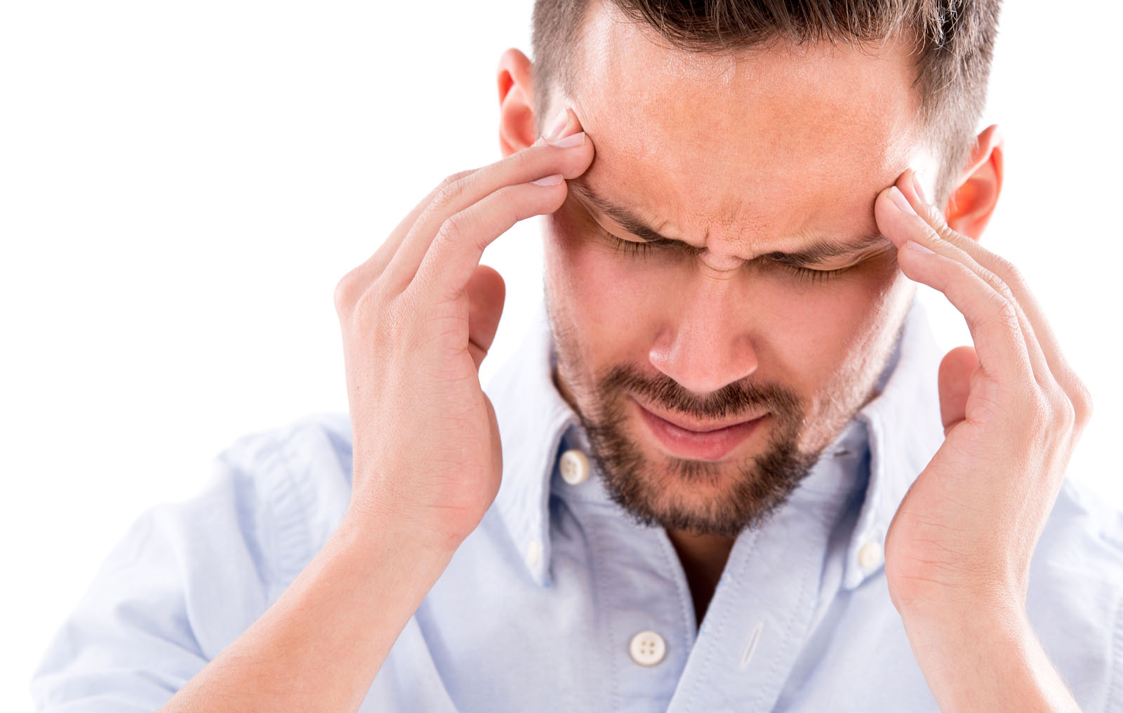 man holding head from tension headache